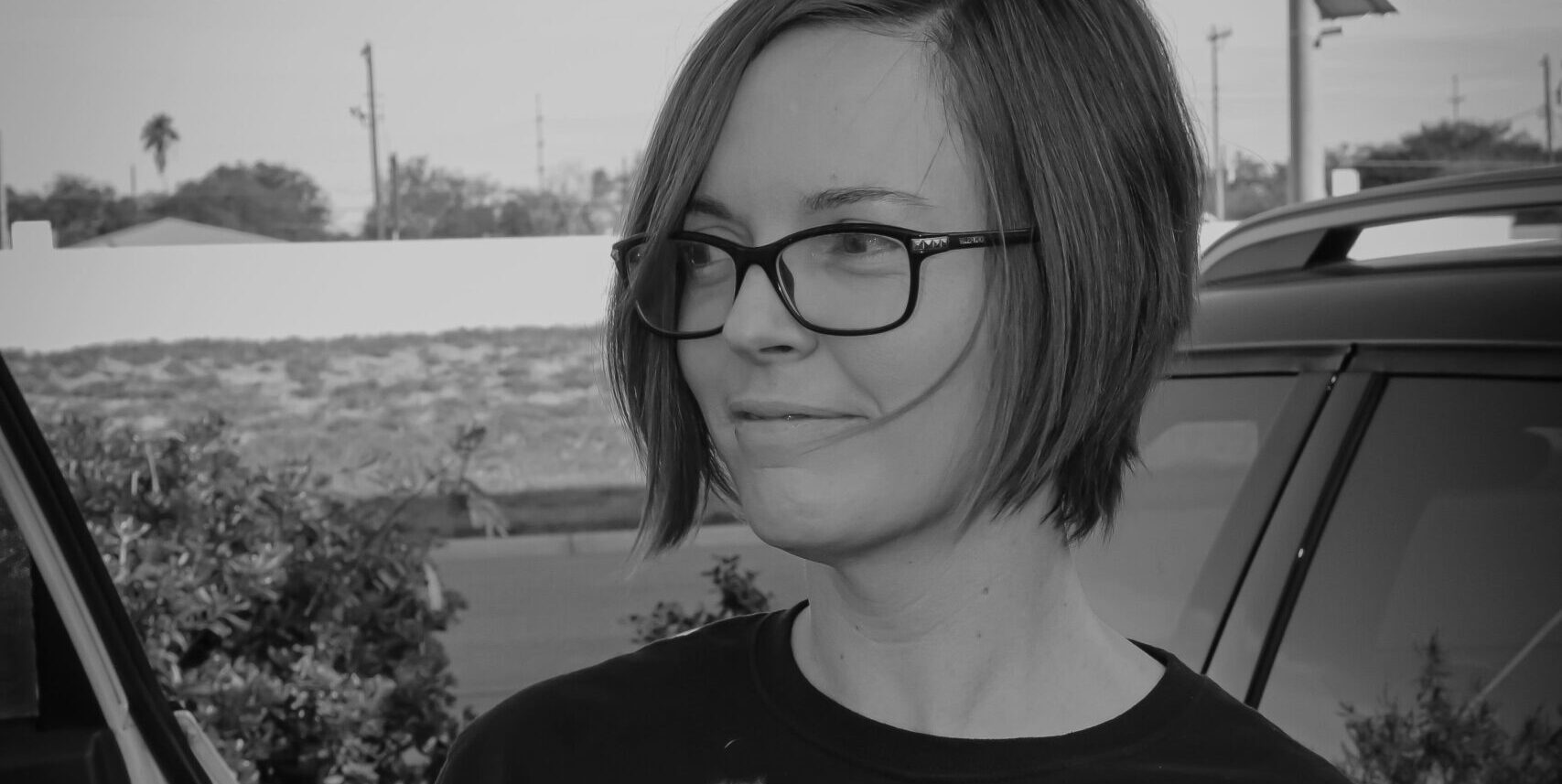 Black and White image of Rise for Animals Director of Grassroots Organizing, Amy Meyer